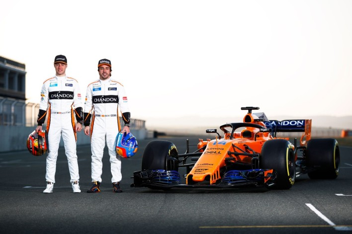 """A handout picture released on February 23, 2018 by McLaren shows McLaren's Belgian driver Stoffel Vandoorne (L) and Spanish driver Fernando Alonso posing by the MCL33 Formula One racing car for the 2018 season. / AFP PHOTO / McLAREN / Steven Tee / RESTRICTED TO EDITORIAL USE - MANDATORY CREDIT """"AFP PHOTO / MCLAREN"""" - NO MARKETING NO ADVERTISING CAMPAIGNS - DISTRIBUTED AS A SERVICE TO CLIENTS"""